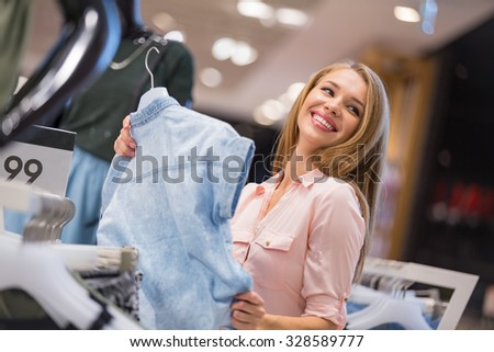 Smiling young girl in the store