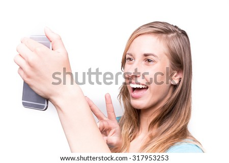 Smiling young girl making selfie photo White Background