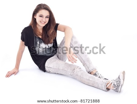 Smiling young girl on a white background. - stock photo