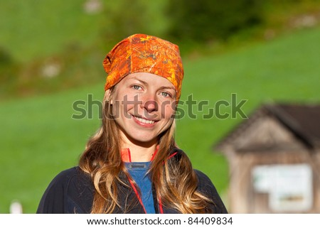 Smiling young girl outdoor portrait - stock photo