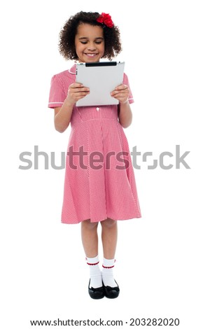 Smiling young girl using tablet computer  - stock photo