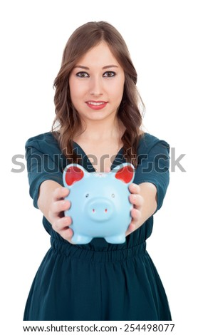 Smiling young girl with a blue money-box isolated on a white background