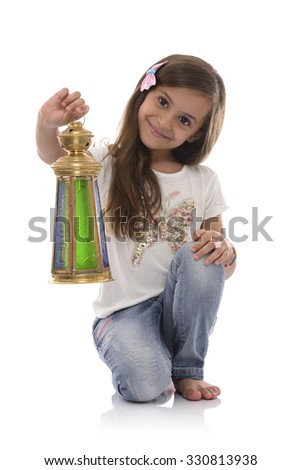 Smiling Young Girl with Ramadan Lantern Isolated on White Background - stock photo