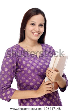 Smiling young Indian student against white background
