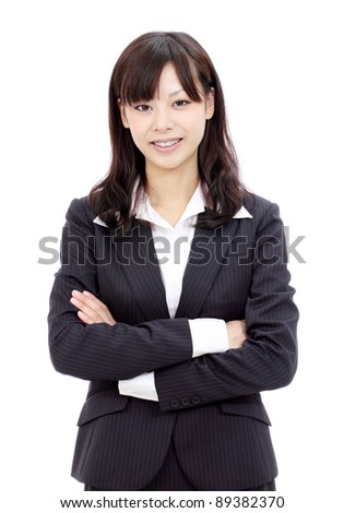 Smiling young japanese businesswoman with arms crossed