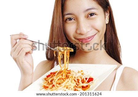 Smiling young lady holding a plate of spaghetti. Isolated in white background. - stock photo