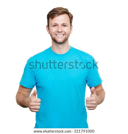Smiling young male wearing blue t-shirt giving thumbs up against a white background - stock photo