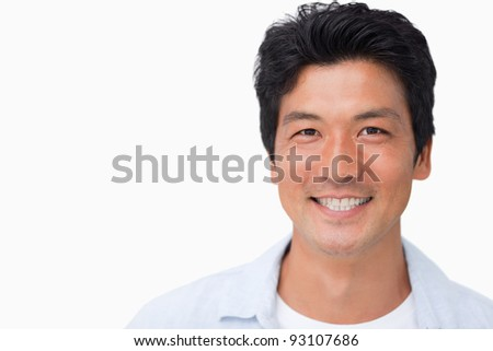 Smiling young man against a white background