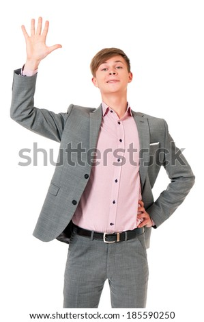 Smiling young man greets with his hand, isolated on white background - stock photo