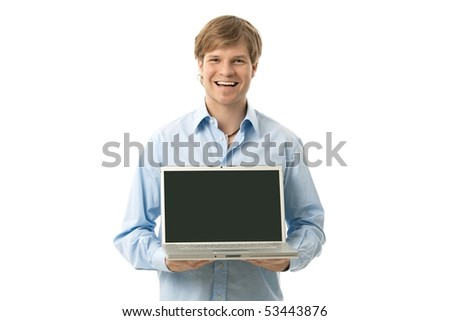 Smiling young man holding laptop computer with blank screen. Copyspace, cutout. - stock photo