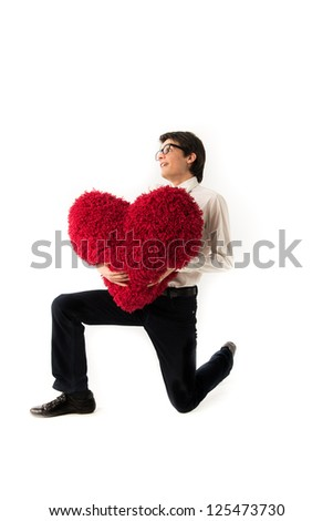smiling young man holds a large hairy red heart - stock photo