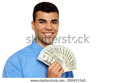 Smiling young man in blue shirt shows you money in hand - stock photo