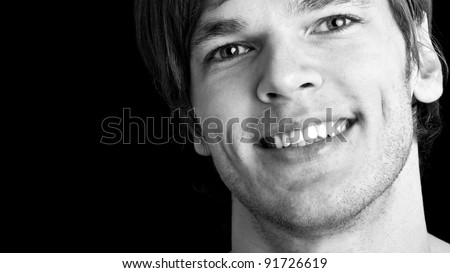smiling young man - isolated on black background - stock photo