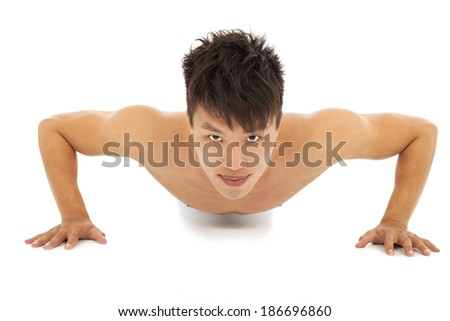 smiling Young man make push-ups and fitness - stock photo