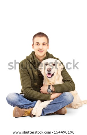 Smiling young man posing with a retriever dog isolated against white background - stock photo