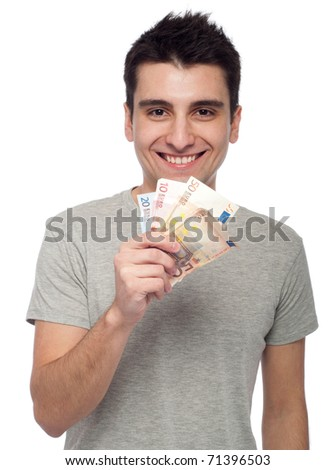 smiling young man showing his money, euro bills (isolated on white background) - stock photo
