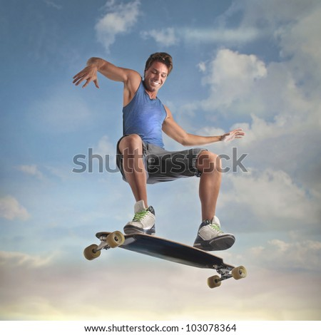 Smiling young man skateboarding - stock photo