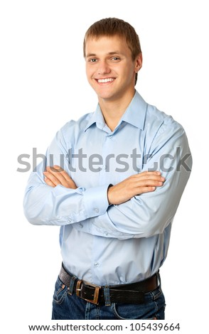 Smiling young man standing with his arms folded against white background - stock photo