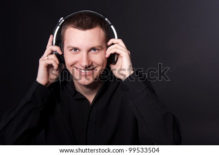 smiling young man wearing headphones
