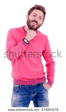 Smiling young man with beard posing with a pink shirt - stock photo