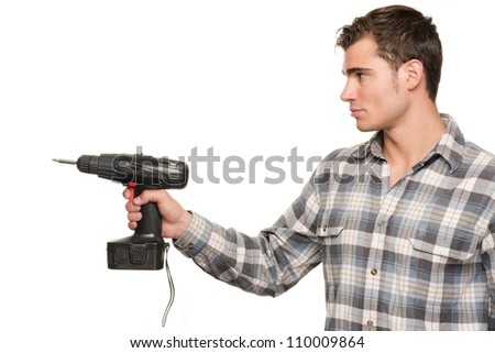 Smiling young man with drill machine in front of white background - stock photo