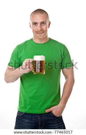 Smiling young man with glass of frothy beer; isolated on white background.