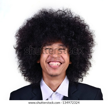 Smiling young man with long hair - stock photo