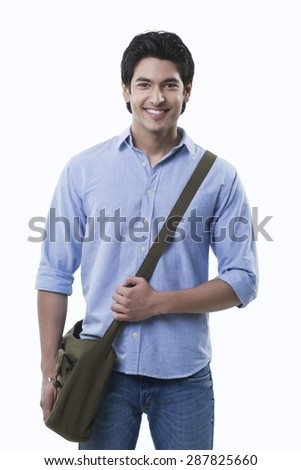 Smiling young man with shoulder bag