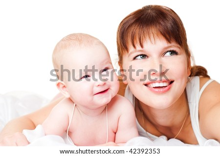 Smiling young mum and the kid isolated on a white background