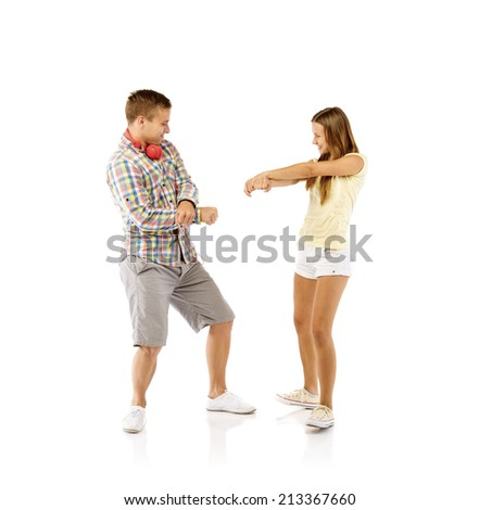Smiling young people dancing, isolated on white background - stock photo