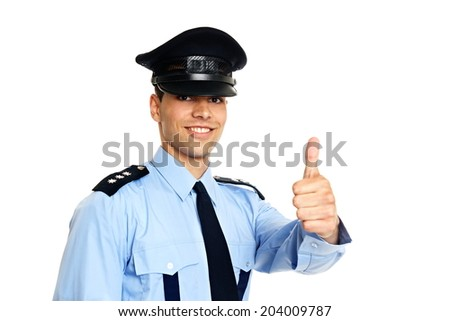 Smiling young policeman in uniform shows you thumb up