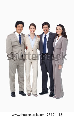 Smiling young salespeople standing together against a white background