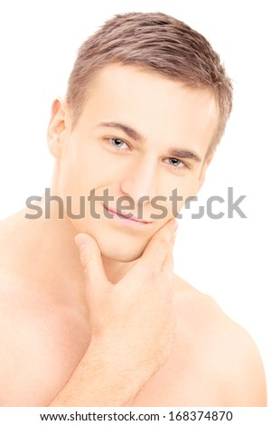 Smiling young shirtless man posing after shaving, isolated on white background