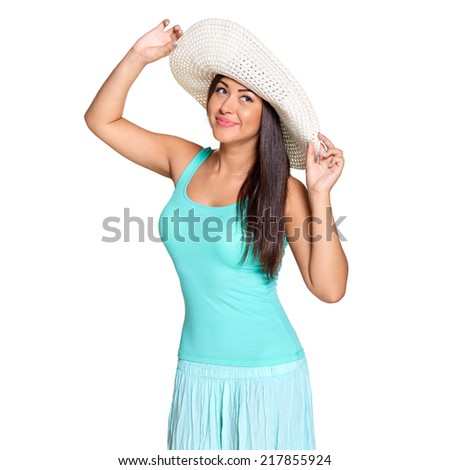 Smiling young sun-tanned woman in  tshirt and straw hat looking out of frame  isolated on white background - stock photo