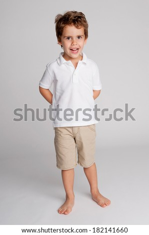 Smiling young toddler boy. Studio portrait. - stock photo