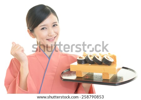 Smiling young waitress with sushi