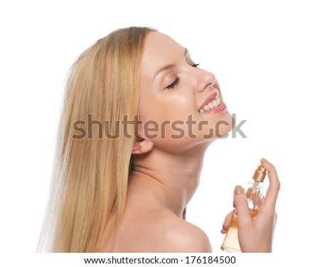 Smiling young woman applying perfume - stock photo