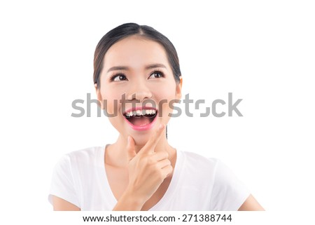 Smiling young woman - cute portrait. Natural candid adorable smile on Asian Caucasian girl on white background. - stock photo