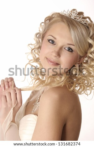 Smiling young woman dressed as a bride isolated on white background.