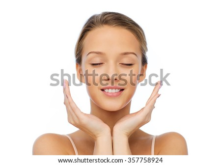 smiling young woman face and hands - stock photo