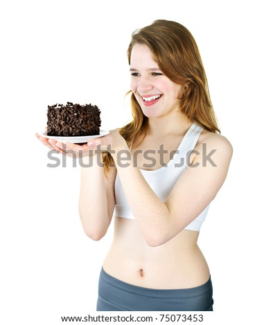Smiling young woman holding a delicious chocolate cake - stock photo