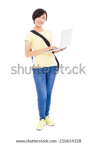 Smiling young woman holding a laptop and isolated on white - stock photo