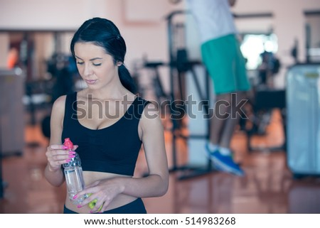 Gym water bottle stock images royalty free images vectors smiling young woman holding bottle with water in gym sciox Gallery