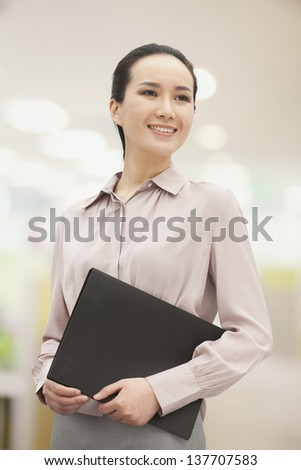 Smiling young woman holding file