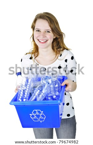 Smiling young woman holding full recycling box isolated on white