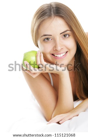 Smiling Young Woman Holding Green Apple - stock photo
