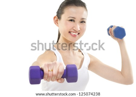 Smiling young woman holding out a weight