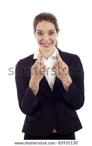 Smiling young woman hoping with fingers crossed isolated over white background - stock photo