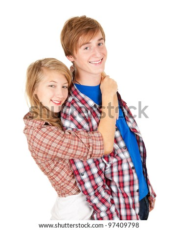 smiling young woman hugging a man from behind - stock photo