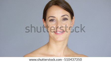 Smiling young woman in brown hair with copy space